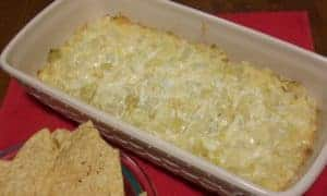 An amazingly easy, and delicious, cheesy artichoke dip that's sure to be a hit.