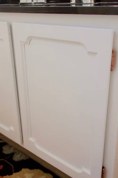 Here's a fantastic, and easy!, way to paint cabinets without sanding!