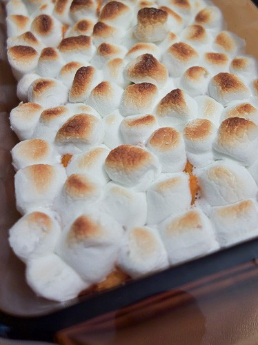 This simple sweet potato casserole is not just for Thanksgiving dinner. With just a few simple ingredients, you can have these creamy sweet potatoes topped with toasted marshmallow any day of the year.