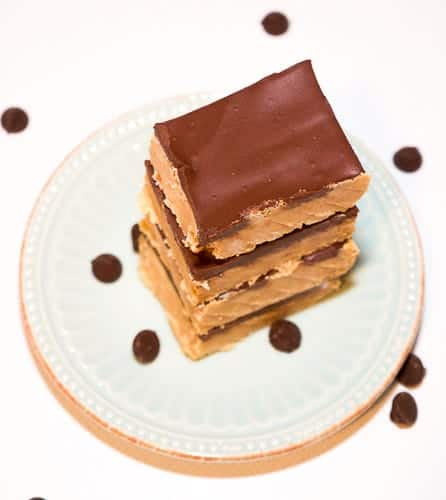 These no-bake peanut butter chocolate bars are melt in your mouth good. With only 5 ingredients, they are a breeze to whip up and taste just like a Reese's Peanut Butter Cup!