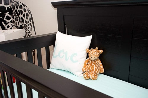 This adorable gender neutral little boy nursery mixes some rustic touches with soft baby touches and colors. Mint accents would work well for either a boy or a girl!