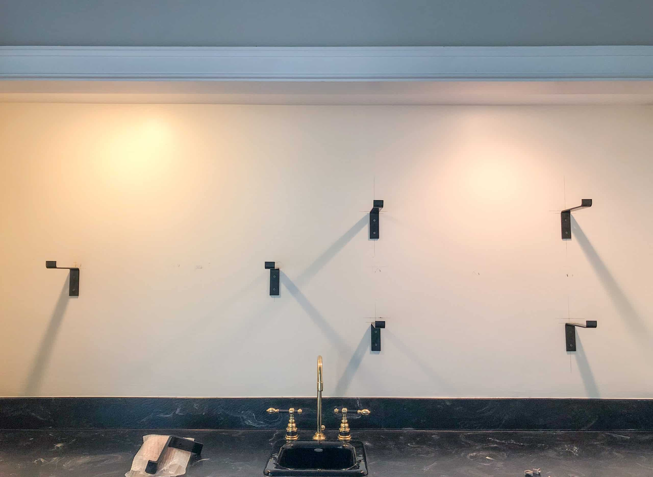 Come see how we are turning our once boring wet bar into something fabulous. This is phase 1 of our wet bar makeover.
