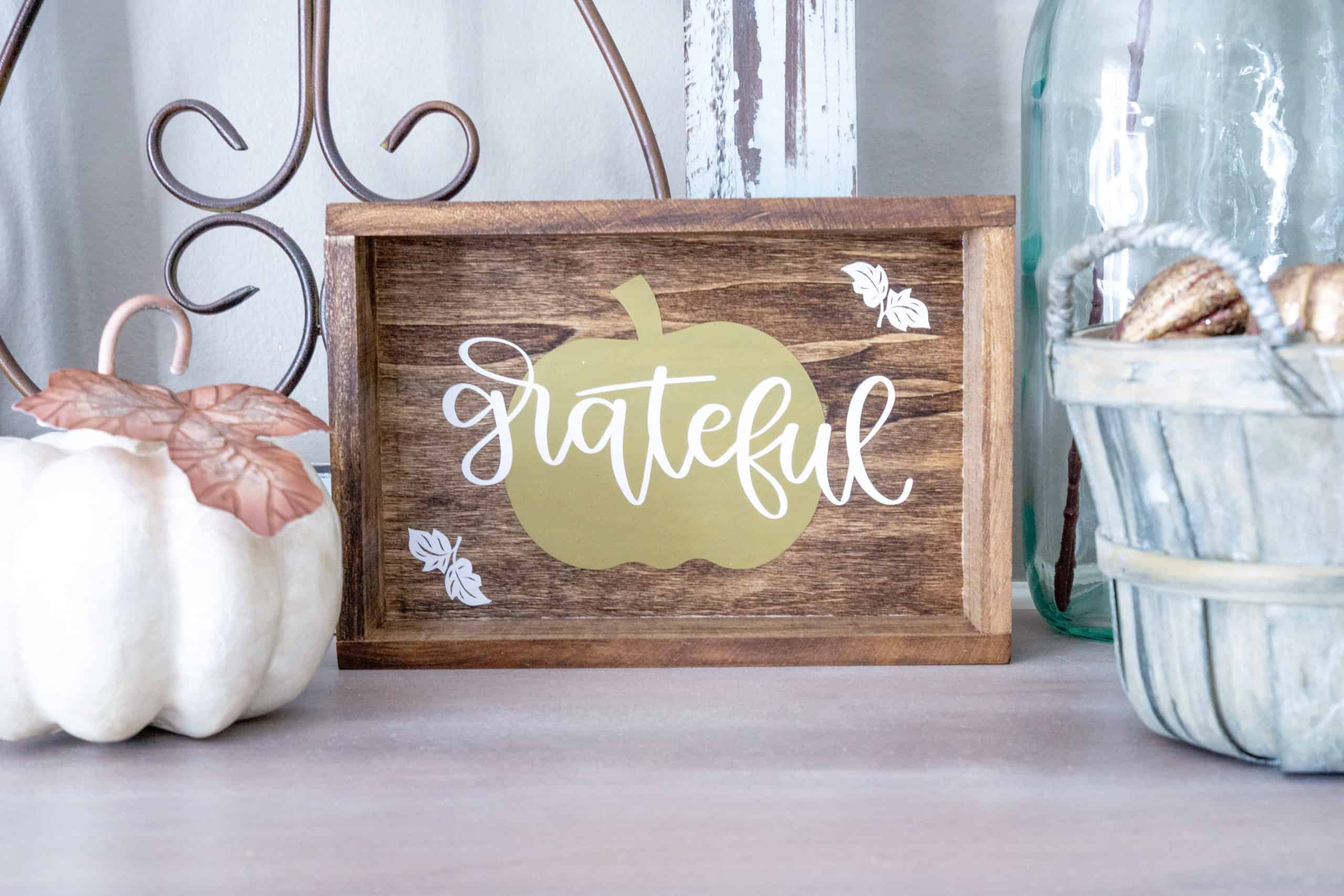 Add a simple touch of fall to your decor with this easy DIY fall sign using Cricut.  It's easy to make, inexpensive, and customizable.