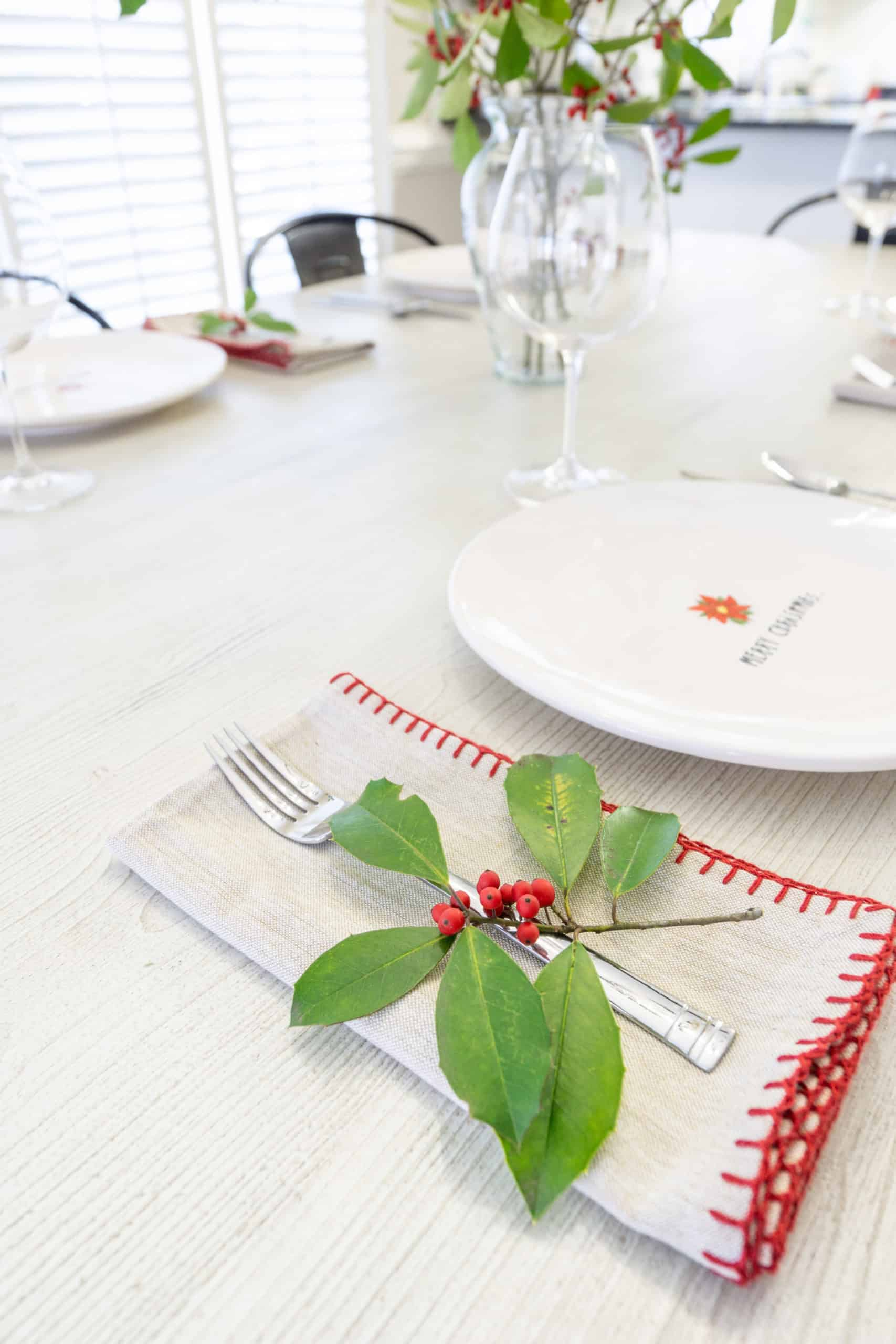 Create a festive table with live holly. This simpleChristmas table setting with holly is easy and inexpensive to put together.